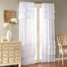 "Vintage chic meets southern charm with oversized ruffles. Panel is made of classic cotton voile. This panel includes a 3"" drapery pocket for easy assembly."