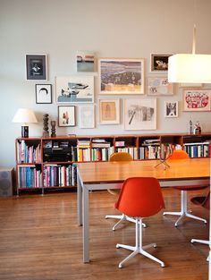 great low bookshelf to showcase gallery of prints