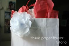 i absolutely love wrapping presents and thought that i would share with you one of my favorite wrapping tricks - the tissue paper flower...