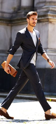 Clutch man satchel with matching loafers.    great summertime suit look - rolled up sleeves