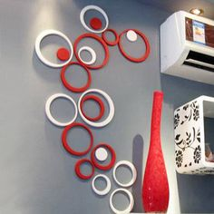 Can buy wooden circles at Hobby Lobby, Spray paint any color and hang in any design...very cool idea.