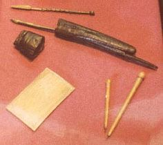 Medieval Scribe Tools. Gothic calligraphy tools from the Museum of London, including leather pen case and cap (missing cords which link them), a quill, a wax tablet, and two objects that are either awls or writing styli, possibly of Ivory with metal tips