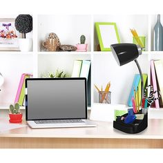 Limelights Organizer Lamp With Stand And Outlet In Black - Stylish and versatile, the LimeLights Organizer Lamp is perfect for keeping your desk clutter-free. This lamp features a flexible gooseneck design, and includes eight compartments for storing small items, a book stand, and an electrical outlet.