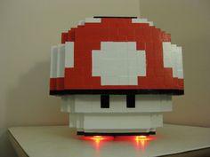 Super Mario : un mod pc en forme de super champignon  Après une version cubique de Link, 8BitBuilder (Etsy) propose désormais un mod PC en forme de super champignon Mario. Proposé à 1243 €, celui-ci est un PC tournant sous Windows constitué de petits cubes en bois peints et collés les uns sur les autres. Son créateur précise qu'il est en mesure d'intégrer les composants PC que vous désirez. le prix varie en fonction de la configuration que vous désirez.