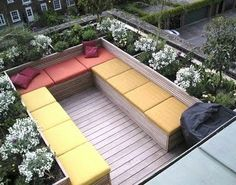 Roof terrace // Jinny Blom Like it - perhaps if the seats slid under the gardens with storage for cushions