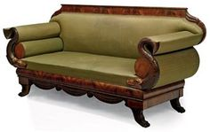 Biedermeier style sofa / c. 1825-50 / love the carved mahogany dolphin arms