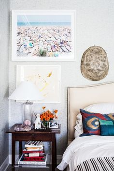 White bedroom with beach print and white table lamp