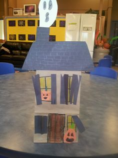 Paper bag haunted houses. I used crayon for the light in the windows