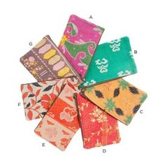 """Hand-stitched from 100% cotton vintage fabric in a kantha pattern, these cosmetic bags from Matta are the perfect carryall for all your travel duds. Choose your own one-of-a-kind piece from our colorful assortment. 8""""W x 5""""H. Zip closure and pocket inside."""