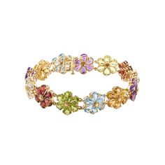 30 ct Multi-Stone Flower Bracelet in 14K Gold.  Wear a bouquet of sweetly shimmering gems around your wrist! Clusters of pear-cut peridot, white topaz, citrine, Swiss blue topaz, garnet and amethyst totaling 30 ct shine from a substantial bracelet crafted in 14K gold. Piece measures 7 1/2 by 1/2 inches.