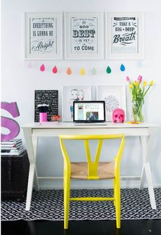 I am loving the pops of color! A lot of office spaces can look scary and daunting. By adding this fun yellow chair, fresh flowers, and rainbow drops it invites the user to sit down and promotes creativity. It is important to make the office space your own and for it to be a place where you can be creative.