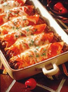 Beef Enchiladas  Ingredients:  1 pound lean ground beef or 1 package fully cooked shredded beef  ½ cup chopped onion  2 cloves garlic, crushed  ½ tsp. salt  ¼ tsp. pepper  2 cans (10 ounces each) mild enchilada sauce  8 small corn tortillas (6-7 inches diameter)  ¾ cup shredded pepper-jack cheese  1 Tbsp. chopped fresh cilantro  sour cream (optional)