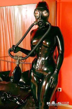 """fetiman: """" Looks like the prelude to some serious rubber torment! Latex Corset, Latex Suit, Latex Dress, Rubber Catsuit, Fishnet Dress, Latex Babe, Scuba Girl, Heavy Rubber, Fetish Fashion"""