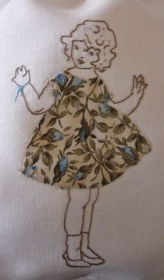 Elisabetta hand embroidery. Like the use of fabric and embroidery together.