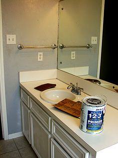 painted counter tops--I might try this on our old harvest gold countertops  that we put in the garage.