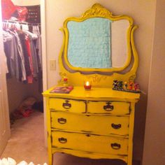 My custom painted antique dresser! Went to antique shop and picked out some pieces I liked. I asked the man if he could have it painted yellow and WALLA! I <3 it!