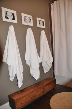 Great idea for a kids bathroom. I also saw a little cup nailed to the wall (or mason jar, etc.) with their name on it -- holds a toothbrush or hair brush brush, etc. above the hanging towel if you don't have a lot of cabinet space
