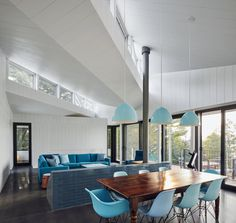 Read Julia Jamrozik and Coryn Kempster designed a holiday house on Stoney Lake in Ontario Canada that combines local hardwearing materials with sustainable design Dining Room Design, Dining Area, Sawtooth Roof, Ontario, Wood Cladding, Casa Real, Metal Roof, Residential Architecture, Home Bedroom