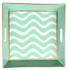 Hand-painted bedside tray with wave motif and contrasting trim. Crafted of recycled metal.   Product: TrayConstructio...