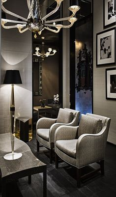 hotel feel.. great seating area space for an apartment. beautifully dark decor with an elegant twist!