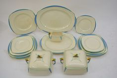 Lot 983 - An Art Deco Burleighware part dinner set with brightly painted unusual shaped handles. Estimate No price released. May 2016