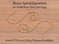 Brass (non-tarnish) Hand-Made Earwires (gemstone dangles not included) Build-Your-Own Earrings with these base Earwires, and Gemstone Dangles available separately. 20 gauge non-tarnish Brass wire was used for these hand-shaped open spiral earwires. Each earwire is about 1 3/8 inches long. You can easily add and switch gemstone dangles, mixing and matching the stones. These earwires are pretty enough to wear on their own, without any gemstone dangles.