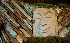 """""""Dynamic Reflection"""" French's Waterscapes LLC, Mariposa Gardening & Design, Gold Award.  A very dynamic use of mixed colored stone and sculpture to create a raised bed or wall."""