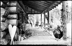 Porch of log cabin in mountains, New Mexico. Photo by T. Harmon Parkhurst, ca. 1925-45. Palace of the Governors Photo Archives 069152.