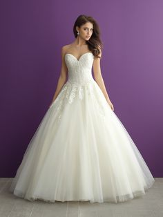 Ruched along the bodice and topped with lace appliques, this ballgown is completely breathtaking // Allure Romance 2961