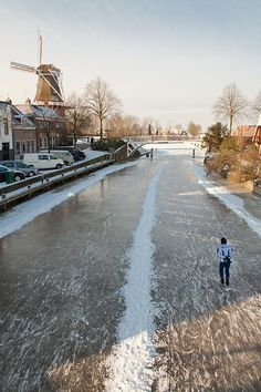 Skating on the canals of Dokkum, a village in the northern of Friesland, The Netherlands
