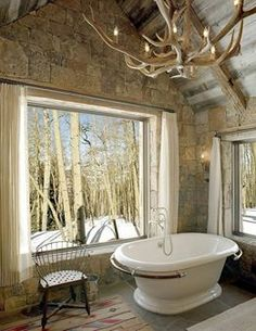 Rustic bathroom with a view! This rustic cabin is beautiful!