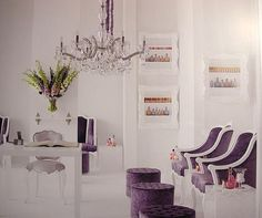 The purple acts as an elegant accent colour in this crisp white salon, upgrading it from cool and clinical to something more luxurious.