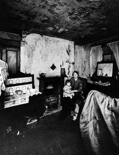 Woman and child in a Liverpool slum. Circa: 1935.