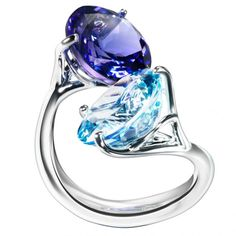 8k white gold ring with round cut aquamarine and round cut tanzanite by Bagués