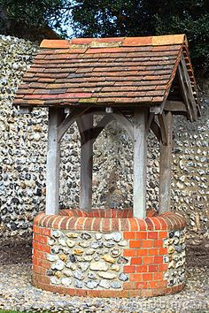 Wishing well Stock Photos and Images. 737 wishing well pictures and royalty free photography available to search from over 100 stock photo brands. Outdoor Projects, Garden Projects, Outdoor Decor, Brick And Stone, Old Stone, Do It Yourself Garten, Well Images, Wells, Gardens