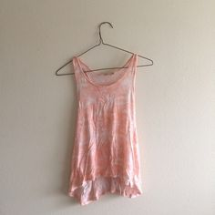 Nordstrom tie dye loose tank Very soft, flowy tie dye crop tank. Worn maybe 10 times but no flaws other than a teensy bit of pilling on the inside of the shirt. A bit wrinkled because it's just been sitting in my closet. Has large arm holes so you can show off a cute bralette or sports bra. Could fit either a small or extra small. Nordstrom Tops Tank Tops