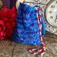 A personal favorite from my Etsy shop https://www.etsy.com/listing/512464575/knitted-pouch-knitted-bag-pouch-gift