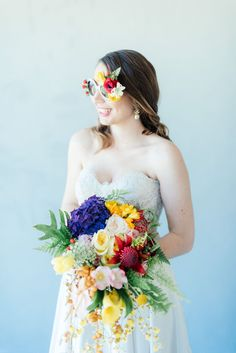 """STUNNING tropical wedding bouquet made from a cascade of bright blue hydrangea, yellow lilies, ferns, tulips. roses, queen annes lace, billies balls, protea and beautiful blooms! Super cute """"tutti frutti"""", Carmen Miranda style tropical flower crown for a tropical bride in bright colors. Fun and cute. Tropical Wedding Ideas photographed by Debbie Lourens Photography http://www.confettidaydreams.com/tropical-wedding-ideas/"""