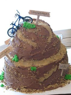 Mountain Biking cake - one of the easiest carved cakes you can do... just make like a tiered cake and cut hunks out!