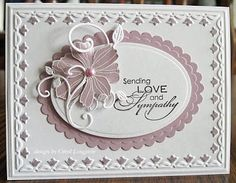 handmade sympathy card ... white and pale plum ... classic layout with a lovely flower and die cut flourishes ... like the way some of the white embossed areas have been colored the same color as the pale plum paper ...