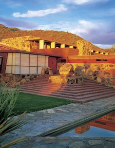 Taliesin West, Scottsdale Arizona.  The winter home of American architect  Frank Lloyd Wright  tapered walls  based on triangles and hexagons  winter home and fellowship   total learning environment  students built  garden room- origami chairs  ceiling height very low  canvas roofing   capturing natural light  reinforced concrete