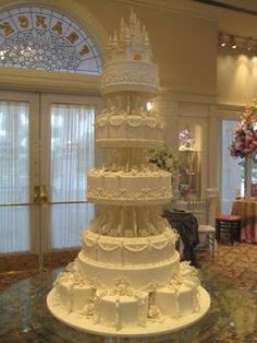 Amazing pure white Cinderella Castle Wedding Cake with exquisitely ornate decorations over five tiers.