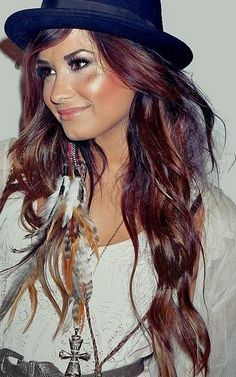 Red is still a trend even into the winter months ladies!Paired with loose wand curls Demi is rocking in this picture!