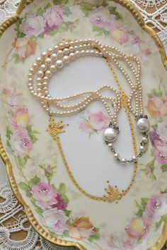 This is how I display my favorite pearls and vintage jewelry...on delicate, flowered china plates and platters. Consignment stores have a great selection.