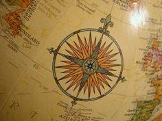 Compass rose on globe.