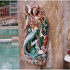 Design Toscano Melody's Cove Mermaid Wall Sculpture Design Toscano http://www.amazon.com/dp/B003M0E2G8/ref=cm_sw_r_pi_dp_SxnHvb16VBPQT