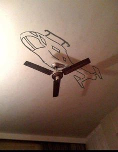 Helicopter Fan! How cool is that!? I would love this in a TV room with a mural of an MH-65.  Go Coast Guard!