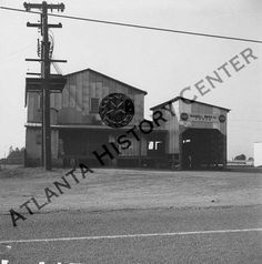 View of the Mansell Brothers Inc. mill in the Lebanon community in Roswell, Georgia. Mansell Brothers feed store and mill was located in the Lebanon community in Roswell, Georgia and operated by C. B. and C. W. Mansell. Atlanta History Center.