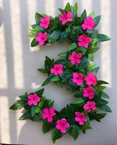 Moana inspired birthday party decor flower numbers