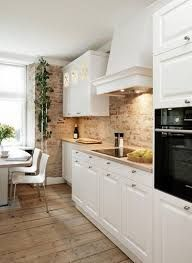 timber + brick + white kitchen